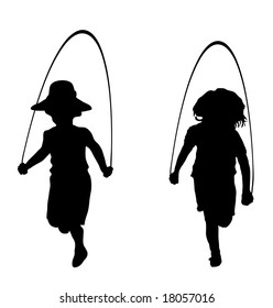 silhouette of children playing jump rope