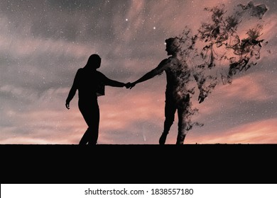 Silhouette of couple in black. The man's figure vanishes in smoke. Concept of end of love, end of love, couple separating, couple in the distance.