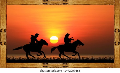 Silhouette of a cowboy riding a wild horse at sunset on a wooden frame