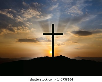 Silhouette of crosses at  sunrise or sunset with light rays.