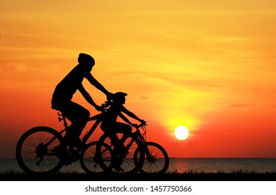 Silhouette  Cycling  on blurry sunrise  sky   background.