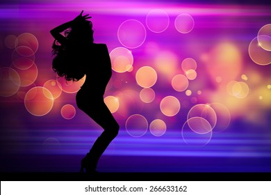 Silhouette of dancing girl in night club with light background