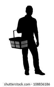 A silhouette of a full length portrait of a man holding an empty shopping basket isolated on white background