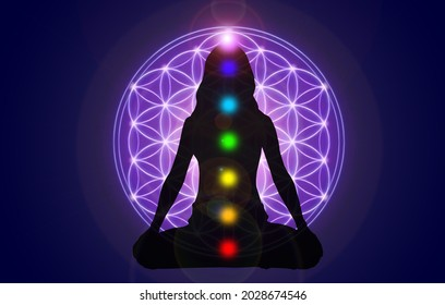 Silhouette of a girl in Lotus position on the background of the universe and the flower of life. A state of trance and deep meditation. A spiritual journey in the universe.