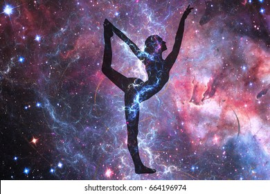 Silhouette of a girl in Nata-Raja position on the background of the universe. A state of trance and deep meditation. A spiritual journey in the universe.
