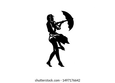 Silhouette of a girl with an umbrella. Girl opens an umbrella in inclement weather.