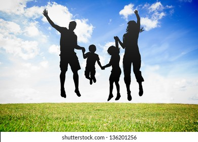 Silhouette of jumping family against sky background