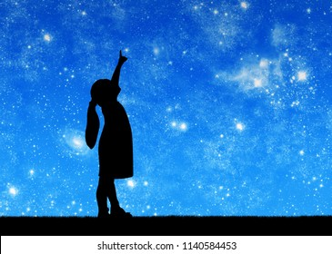 Silhouette, little baby girl looking at starry sky and showing thumb up. Conceptual image of a carefree childhood
