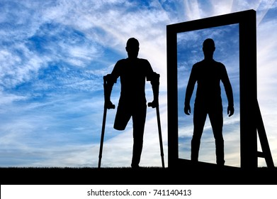 Silhouette of a man with an amputated leg with crutches sees a reflection of herself in the mirror healthy. The concept of prosthetic legs