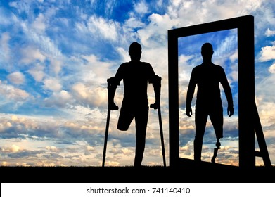 Silhouette of a man with an amputated leg sees a reflection of himself in the mirror with a prosthetic leg. The concept of prosthetic legs