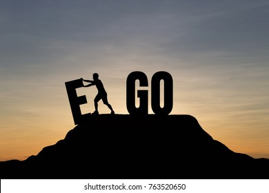 Silhouette man change EGO to GO text on Mountain, sky and sun light background. Business, success, challenge, motivation, achievement and goal concept.