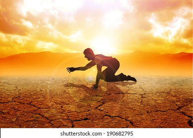 Silhouette of a man crawling on arid land