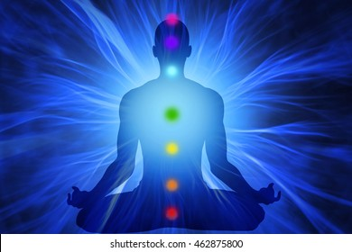 Silhouette of man doing yoga and where has scored seven chakra points