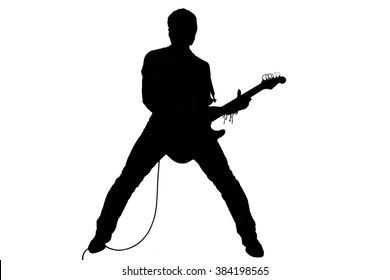 Silhouette of a man with an electric guitar. Isolated on white background.