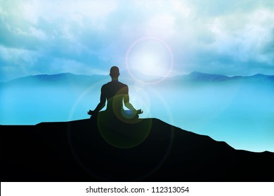 Silhouette of a man figure meditating on the mountain