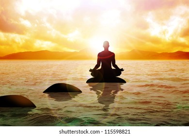 Silhouette of a man figure meditating on calm water during sunrise