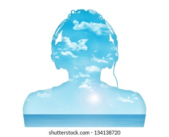 silhouette of a man in headphones listening to the music, nice blue sea landscape inside him