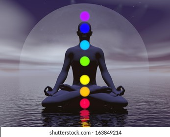 Silhouette of a man meditating with seven colorful chakras upon ocean by full moon dark night