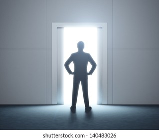 Silhouette of a man and opened doorway