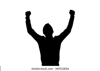 Silhouette of a man in victorious gesture