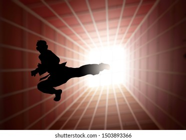 Silhouette of a martial art pugilist doing a flying-kick.