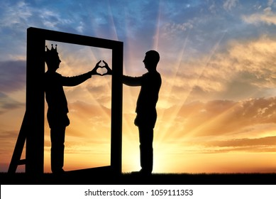 Silhouette of a narcissist man and hand gesture of a heart in reflection in the mirror and crown on his head. The concept of narcissism and selfishness