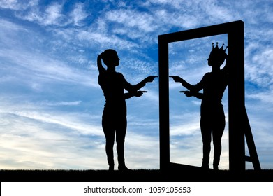 A silhouette of a narcissistic woman raises her self-esteem in front of a mirror. The concept of narcissism and selfishness
