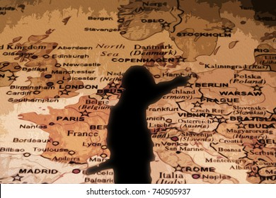 Silhouette of Nazi soldier over map of Europe