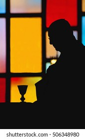 silhouette of a priest during the Eucharist of a Catholic mass depiction