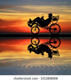 silhouette recumbent bicycle on sunrise
