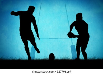 Silhouette of rugby player against rugby pitch