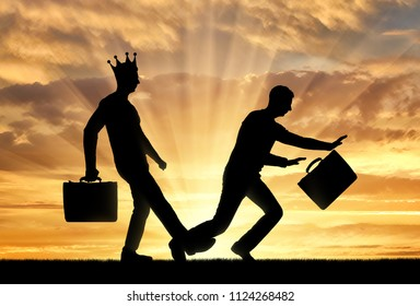 The silhouette of a selfish man with a crown on his head, expose a leg to another man who stumbles over her. Conceptual scene of selfishness