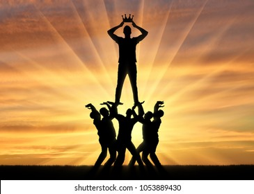 Silhouette of a selfish and narcissistic man dressing a crown, he stands on a crowd of men. The concept of selfishness and narcissistic personality