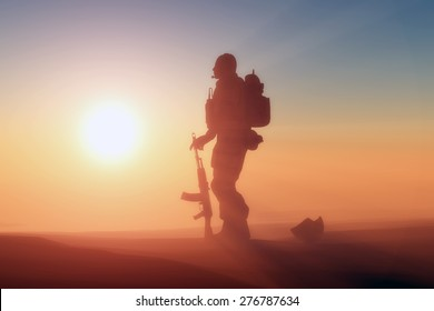 Silhouette of a soldier against the sun.