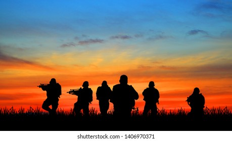 Silhouette of soldier with rifle on a sunset