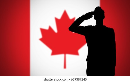 Silhouette of a soldier saluting against the canada flag