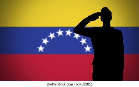 Silhouette of a soldier saluting against the venezuela flag