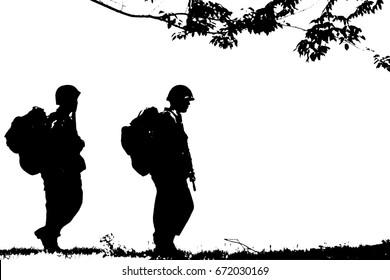 Silhouette of soldiers walking.