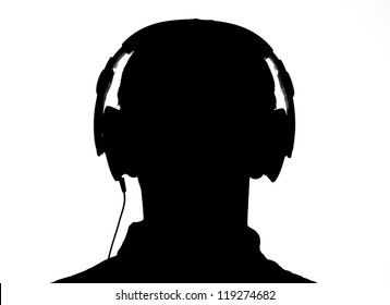 Silhouette of someone's head listening to music with his headphones