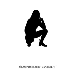 Silhouette of a teenage girl with long hair squatting with her hands on her hips.