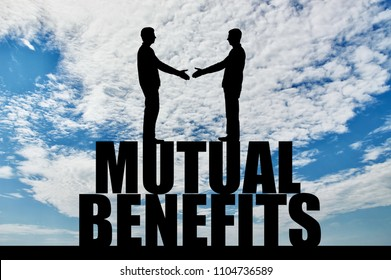 Silhouette two men are going to shake hands, standing on the word mutual benefit. The concept of mutual benefit in business