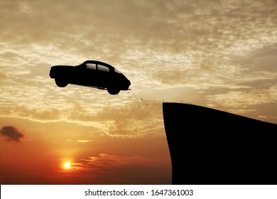 Silhouette of vehicle flying off a high precarious cliff against a surreal sunset for the concept of driven off the edge.