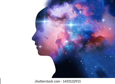 silhouette of virtual human with aura chakras on space nebula , represent meditation,yoga 