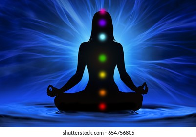 Silhouette of woman doing yoga and where has scored seven chakra points
