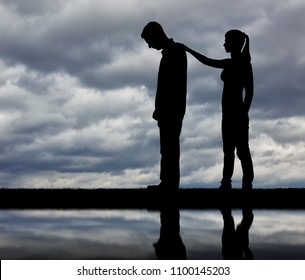 A silhouette of a woman morally supports a sad man. The concept of support and assistance