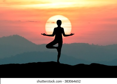 Silhouette Yoga woman meditating on the beach during Omega sunset blood colors Inferior-Mirage