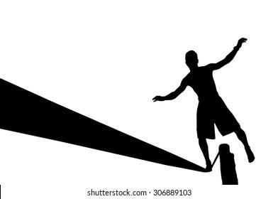 Silhouette of young man balancing on slackline. Slackliner balancing on tightrope silhouette.