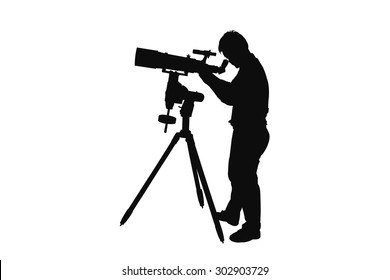 Silhouette of young man looking  through a  telescope