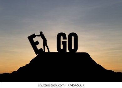 Silhouette young woman change EGO to GO text on Mountain, sky and sun light background. Business, success, challenge, motivation, achievement and goal concept.