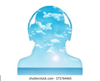 silhouette of a young woman in headphones listening to the music, beautiful blue sea landscape inside her
